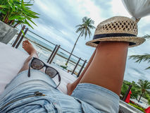 Sun and shades. Chilling in the sun with shades and hats, Anantara Lawana, Koh Samui, Thailand, July 2014 stock image