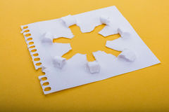 Sun shape paper. Sun shape made through torn paper in white background Royalty Free Stock Photography