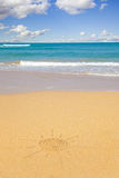 Sun shape written in the sand of a beach Royalty Free Stock Image