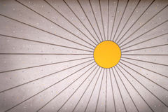 Sun-shaped wooden wall with small light points Stock Photo