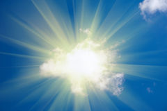 Sun shine from behind cloud. On blue sky Royalty Free Stock Photo