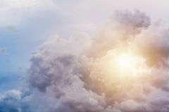Sun shine through clouds after storm. Beautiful cloudy background Royalty Free Stock Images
