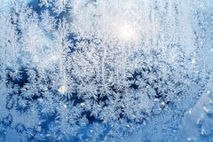 Sun shine through frosted glass on window. Royalty Free Stock Image