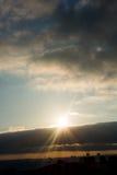 Sun shine over dark clouds. İn sky Stock Photography