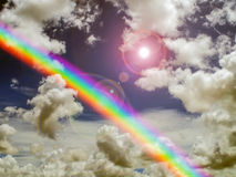 Sun shine rainbow and sunlight in dark sky. Concept love, god bless, god gift, wish, happy, lucky Royalty Free Stock Images
