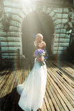 Sun shines above a gorgeous wedding couple.  Royalty Free Stock Images