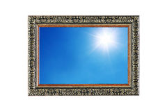 sun shines on blue sky in wooden frame isolated on white Stock Photography