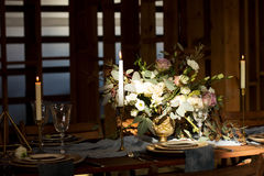 The sun shines on the bouquet on Decoration wedding table. The sun shines on the bouquet on Decoration wedding table before a banquet in a wooden barn. Wedding Royalty Free Stock Photos