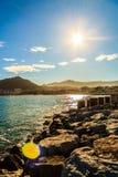 The sun shines on the coast Stock Photos