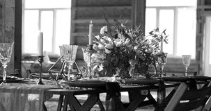 The sun shines Decoration wedding table. Big windows. Black and. The sun shines Decoration wedding table before a banquet in a wooden barn. Big windows. Wedding Royalty Free Stock Image