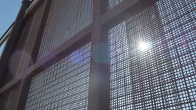 Sun Shines Through Fence on US and Mexico Border. Pan shot of the sun shining through the fence on the border of the US and Mexico in the afternoon stock footage