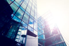 Sun shines through glossy office building Stock Images