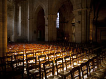 Sun shines inside a church. Sun shines inside an empty church in France royalty free stock images