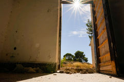 Sun shines into open door. Sun is shining through open door of an abandoned house Royalty Free Stock Image