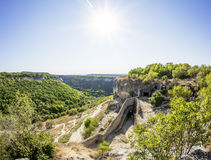 The sun shines over the ancient cave city chufut-Kale, Crimea, U Royalty Free Stock Photography
