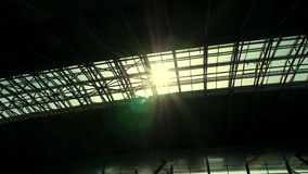 The sun shines through the roof of the airport pavilion.  stock video