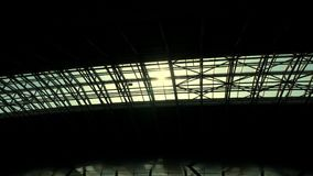 The sun shines through the roof of the airport pavilion.  stock video footage