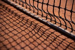 Tennis net throws a shadow royalty free stock photography