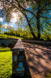 The sun shines through trees over Burnside Bridge, at Antietam National Battlefield Royalty Free Stock Photography