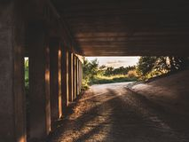 Sun shines under the bridge ,Way u-turn under road with bridge pillar,A lonely place at night.  stock photography