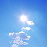 sun shines with white clouds Royalty Free Stock Image