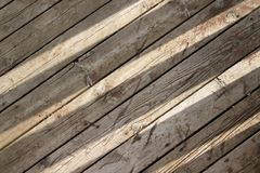 Sun shines through on wooden boards background Royalty Free Stock Images
