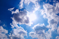 Sun shining. Through the clouded sky Royalty Free Stock Photo
