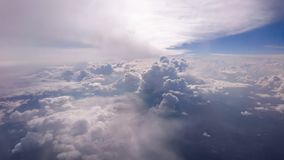 Sun shining above cloud formations Stock Image