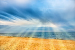 Sun shining above tropical beach Stock Images