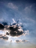 Sun shining from behind clouds Royalty Free Stock Photo