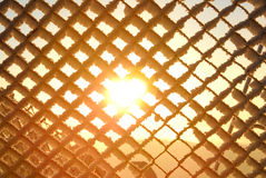 Sun shining behind the fence Royalty Free Stock Image