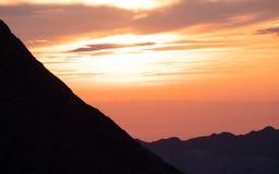 Sun shining behind mountain range, dramatic sunset in the swiss alps brienzer rothorn. Switzerland stock image