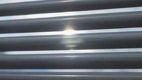 Sun shining through the blinds stock photography