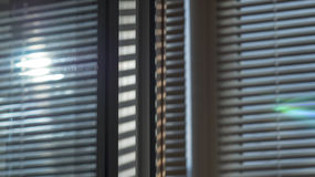 The sun is shining through the blinds Royalty Free Stock Photography