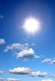 Sun shining in blue sky Royalty Free Stock Photography