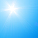 Sun shining in blue sky Stock Photos