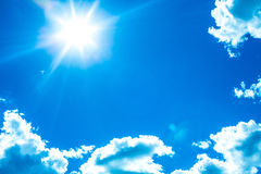 Sun shining in blue sky Royalty Free Stock Images