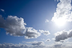 Sun shining in blue sky with clouds Royalty Free Stock Photo