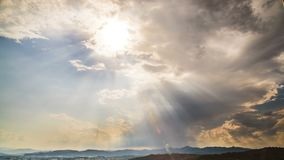 Sun shining brightly through clouds in heavenly sky, god blessing, timelapse