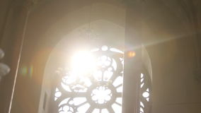 Sun shining through cathedral stained glass window, religion, faith stock video footage