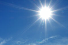 Sun shining in clear blue sky Royalty Free Stock Photo