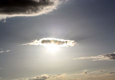 Sun Shining Through Cloud Royalty Free Stock Images