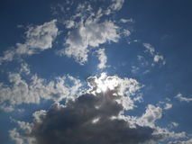 Sun Shining Through Clouds on Coney Island. Stock Photography