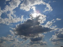 Sun Shining Through Clouds on Coney Island. Royalty Free Stock Image