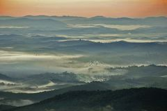 Sea of clouds at sunrise in the mountains stock photography