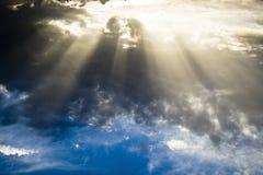Sun shining through dense clouds Royalty Free Stock Photo