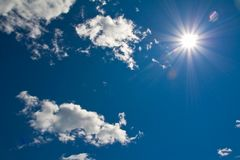 Sun shining down from a clouded sky Royalty Free Stock Photography