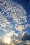 Sun shining through dynamic clouds. stock photos