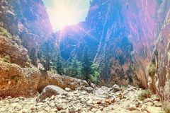 Sun is shining through the edge of canyon in Samaria Gorge Stock Image