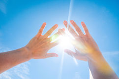 Sun is shining through fingers Royalty Free Stock Photo